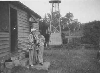 Annie Mitchell Hyde and Joyce Ford at the Eraring cottage. Monkey cages in background